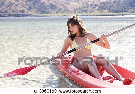 stock photograph of a woman in a kayak u13960159 search stock