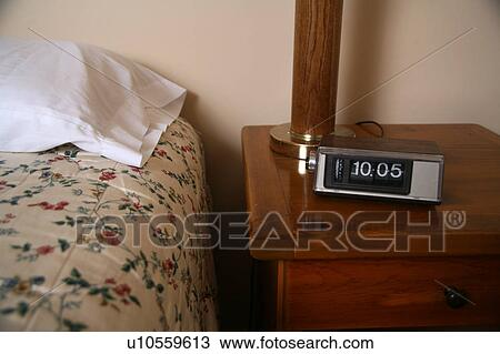 Alarm clock in bedroom Stock Image | u10559613 | Fotosearch