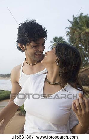picture of young couple romancing on the beach goa india u15681867