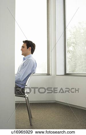 Businessman Sitting On Chair In Office