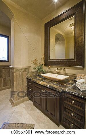 Stock Photography Of Dark Brown Bathroom Unit With Leather Mirror