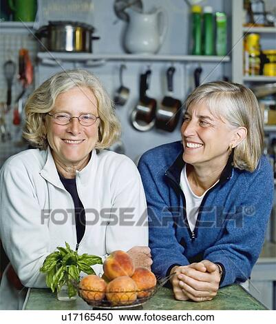 Mature lesbians in the kitchen