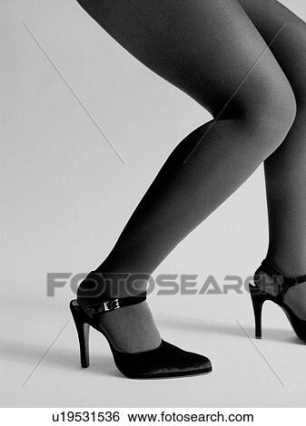 942c6140b71 Stock Photograph - Woman s legs with stockings and high heels