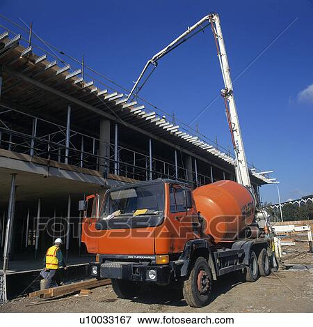 picture of cement truck delivering concrete on a building site