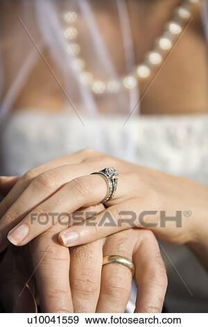 Stock Photograph Of Caucasian Mid Adult Male And Female Hands With