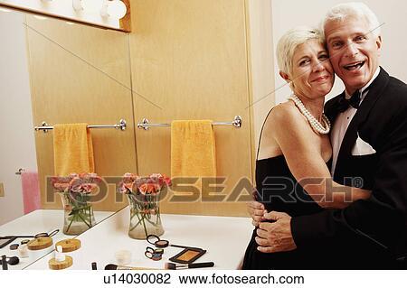 Man And A Senior Woman Embracing