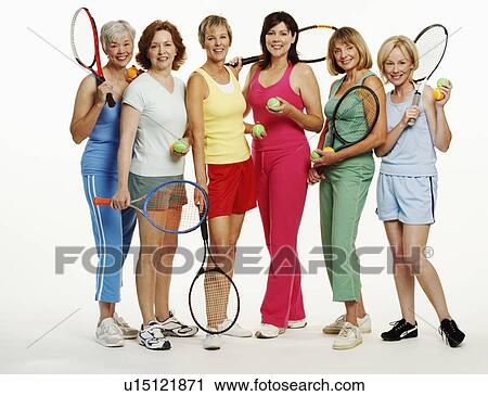 Portrait of a group of mature women holding tennis rackets and tennis balls  Stock Image   u15121871   Fotosearch