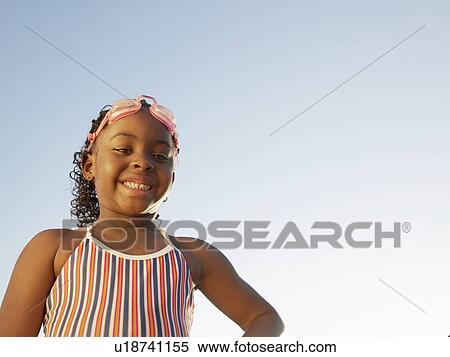 Stock Image Of Young Girl In Swimming Costume Portrait Low Angle