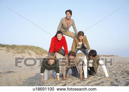 Five people forming human pyramid (portrait) Stock Image