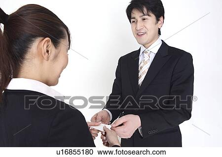 Stock photography of business card exchange the japanese the business card exchange the japanese the business colourmoves