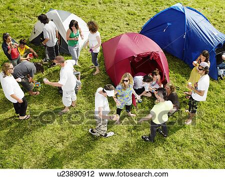 Fotosearch & Group partying outside tents Stock Photo