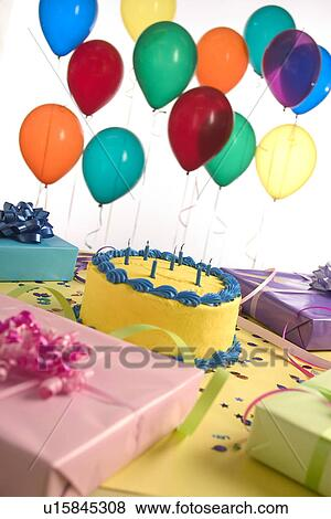Birthday Cake And Presents With Balloons
