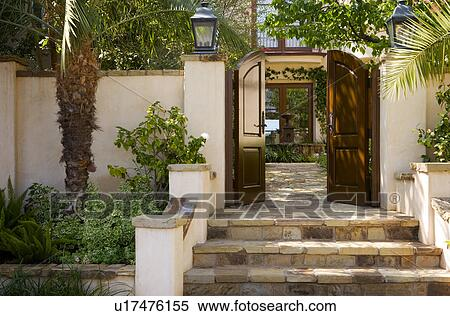 Front Gate And Steps To Spanish Style Home Stock