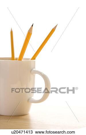 Colección de foto - tres, lápices, en, un, taza para café, con ...
