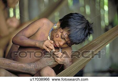 stock images of young girl cleaning feet of an old woman south of