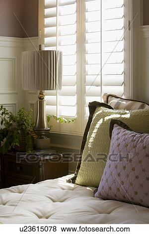 Pictures Of Purple And Green Decorative Pillows On Bed Near Window Adorable Purple And Green Decorative Pillows