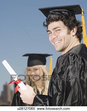 Stock Image Of Man Wearing Graduation Cap And Gown With Diploma