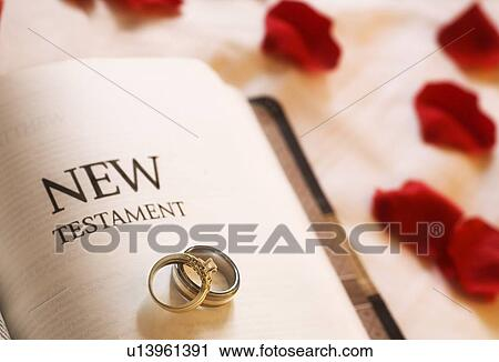 stock photography of wedding rings on the new testament bible