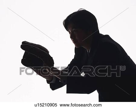 Bsinessman Catching A Ball With Glove Side View Silhouette Stock Photography