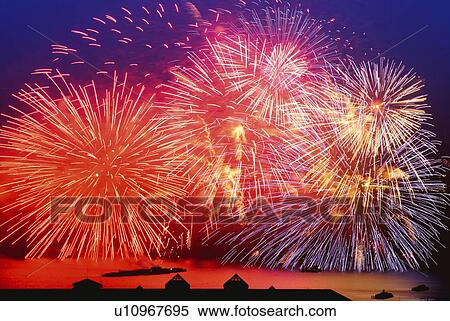 Stock Image of Fireworks exploding in sky, long exposure ...