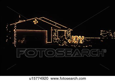 Outline Of House Lit By Christmas Lights