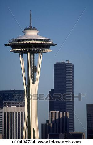 stock photo of space needle standing tall with seattle skyscrapers