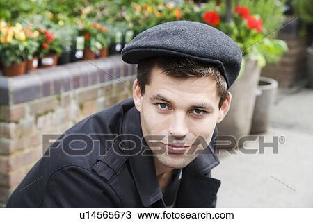 Stock Photo of Young man wearing flat cap (portrait) u14565673 ... 0eb58675bd9