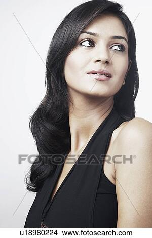 stock photo of side profile of a young woman looking side ways