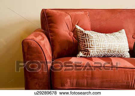 Bright red suede sofa and pillow Stock Photo | u29289678 | Fotosearch