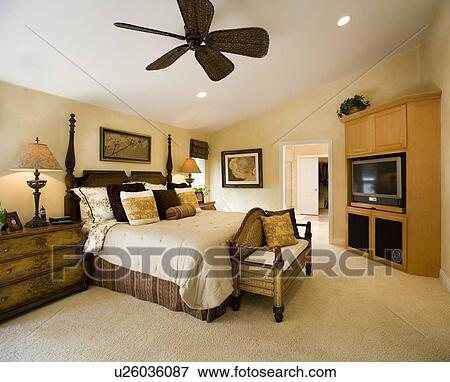 Master Bedroom With Contemporary Ceiling Fan And Built In