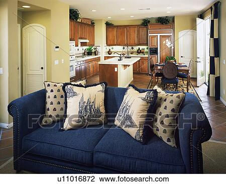 Traditional Kitchen and Blue Living Room Sofa Stock Image