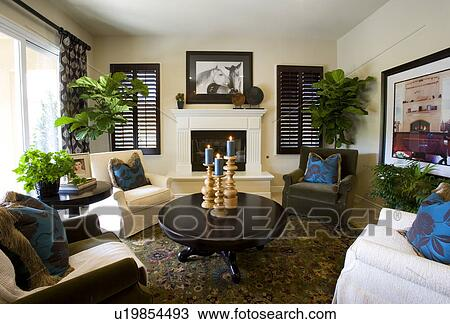 Stock Photo Of Living Room With Four Chairs Circling A Round Table