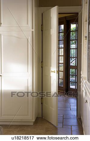 Picture Of Open Kitchen Door With View Of French Doors Leading