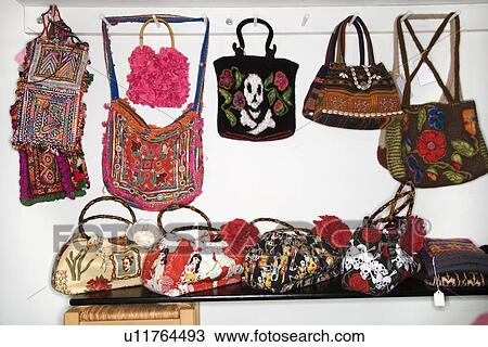 Stock Photo Unique Handbags Hanging In Retail Fotosearch Search Images
