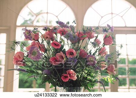 Stock Photo Of A Vase Of Flowers Displayed Near A Window U24133322