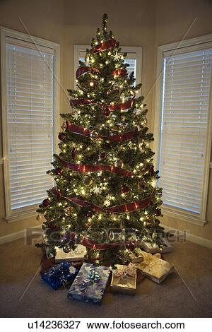 Christmas Presents Under Tree.Christmas Presents Under Decorated Christmas Tree Stock Photo