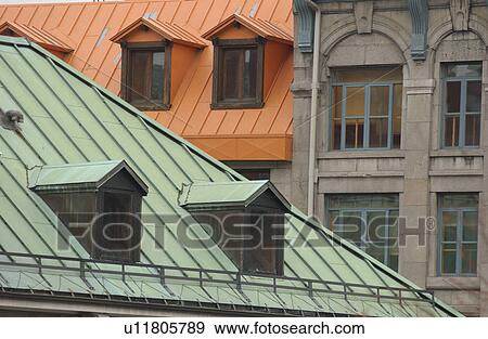 Attic Windows On A Roof Of House