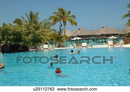 People Swimming In A Pool Moorea Tahiti French Polynesia