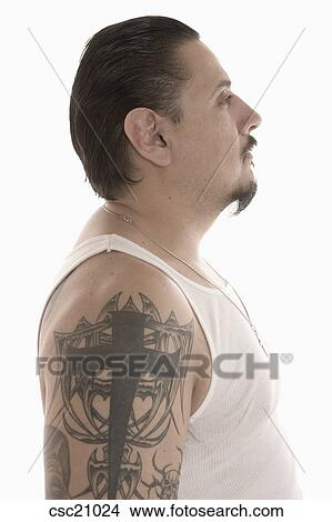 Stock photo of hispanic man with tattoos on upper arm for Arm mural tattoos
