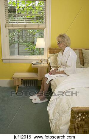 Stock Image Of Senior Woman Sitting On Edge Of Bed