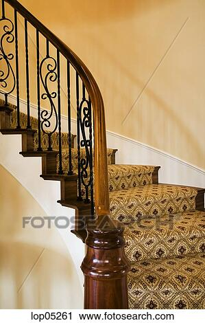 Stock Photography   Winding Staircase With Wrought Iron Railing. Fotosearch    Search Stock Photos,