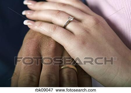 Picture Of Couple Wearing Wedding Rings Holding Hands Rbk09047