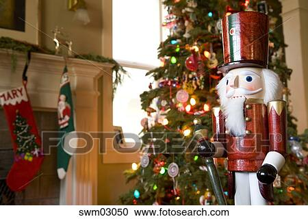 Nutcracker Christmas Tree Clipart.Nutcracker Beside Christmas Tree Stock Image