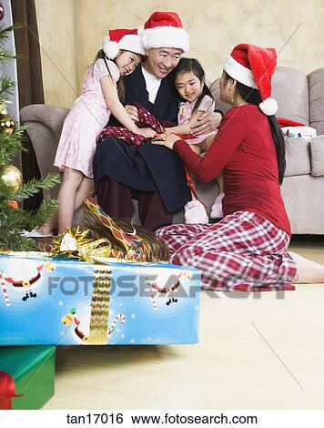Stock Images of Asian family bonding on Christmas morning tan17016 ...