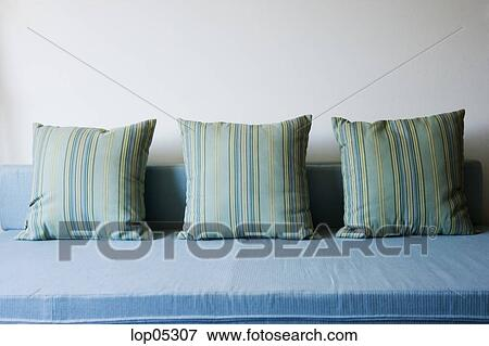 Three Striped Pillows on Blue Sofa Stock Photo | lop05307 ...
