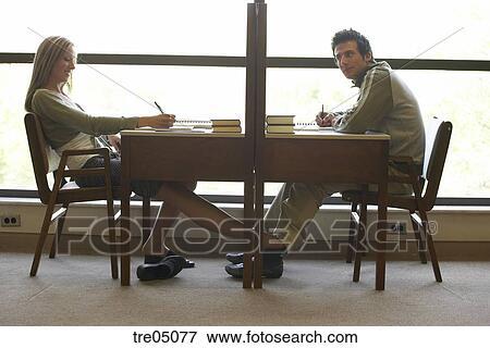 Stock Photo Woman Rubbing Man S Leg Under The Table Fotosearch