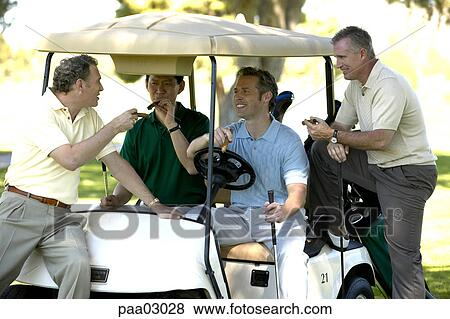 Pictures of Men relaxing with cigars in golf cart paa03028 - Search on exciting golf, natural golf, lazy golf, peaceful golf, cute golf, captain kangaroo golf, playing golf,