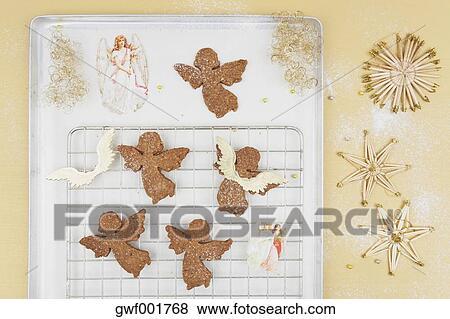 Freshly Baked Christmas Angel Cookies On Baking Tray Stock Photo
