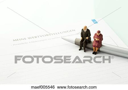Stock Images Of Figurines Sitting On Pen With Advance Directive