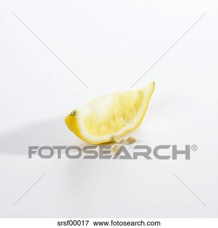 squeezed lemon slice on white background picture